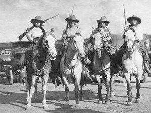 Cattlewomen-horseback